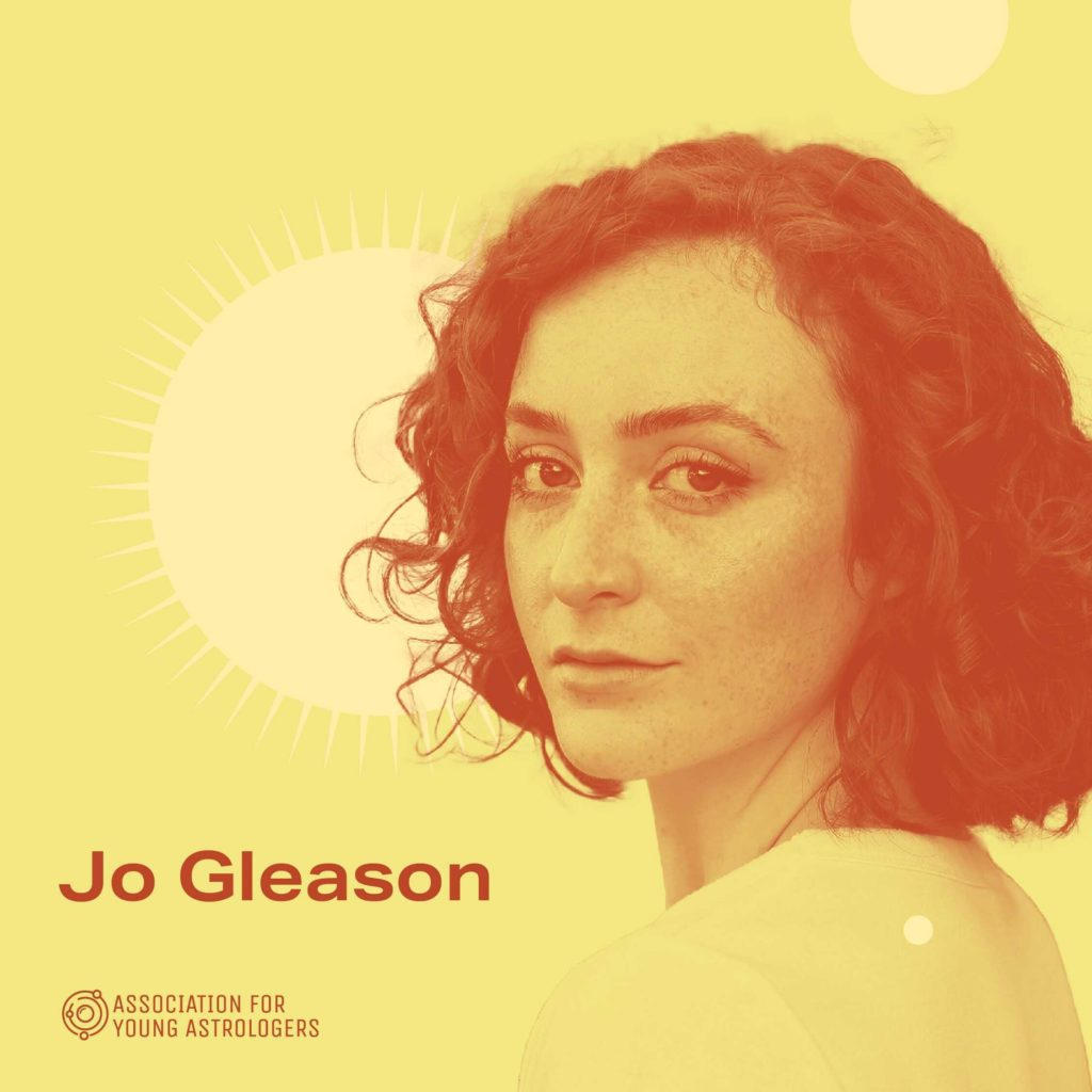 a yellow image with an orange-toned portrait of Jo Gleason. She is a white woman looking over her shoulder at the camera. there is a bright sun behind her.